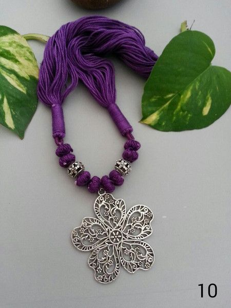 German oxidised silver flower pendant with purple thread