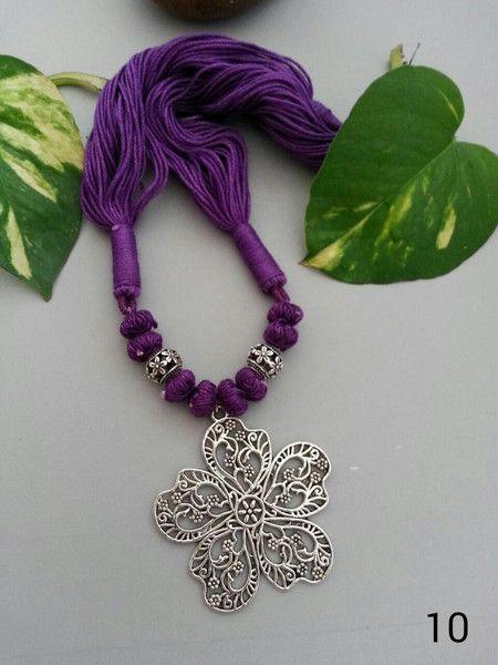 German oxidised silver flower pendant with purple thread