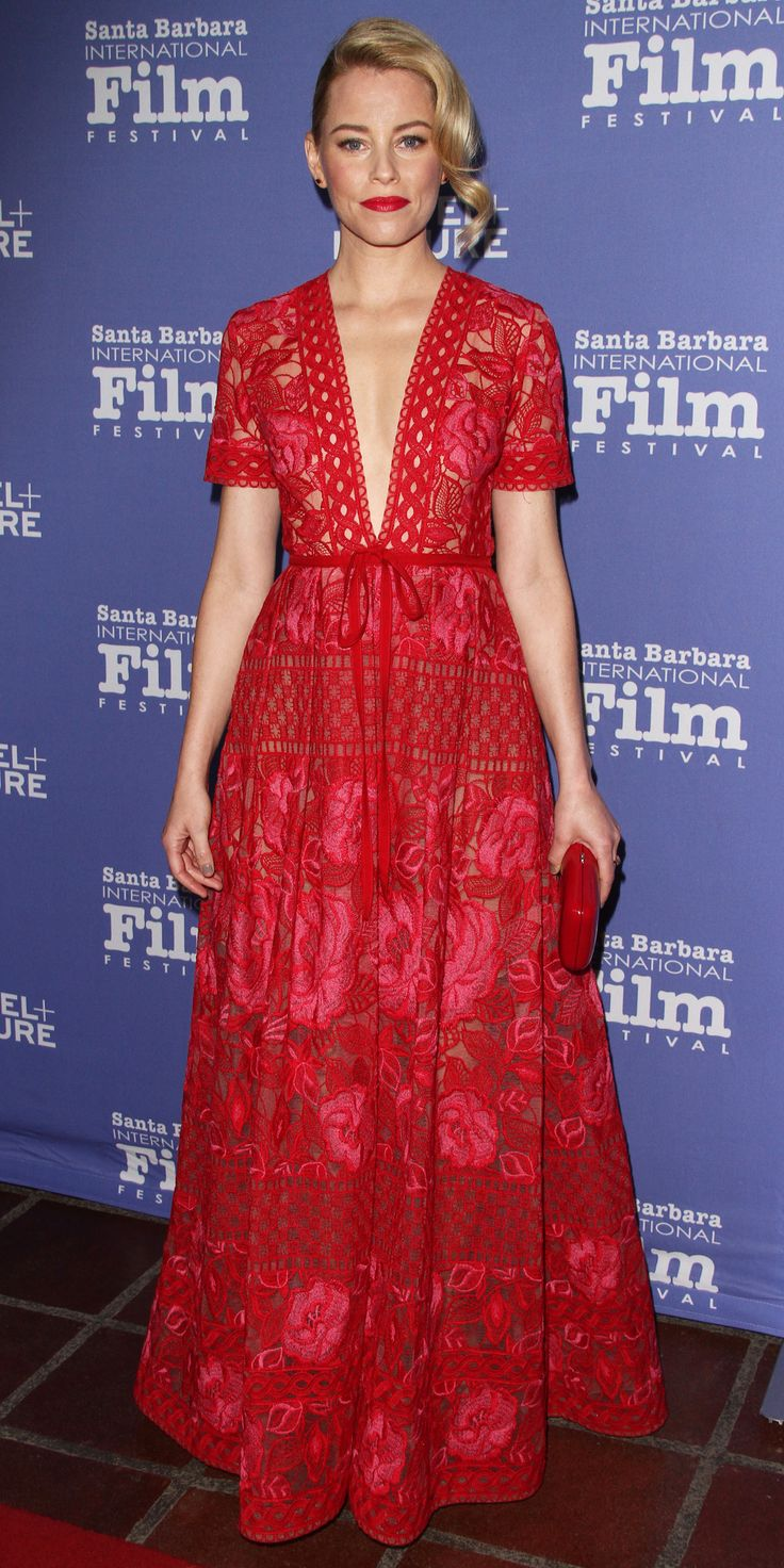 Elizabeth Banks was red-hot at the 31st Santa Barbara International Film Festival in a plunging floral-embroidered, macramé lace Elie Saab gown that she styled with a red clutch, Jane Taylor studs, and a Meira T ring.