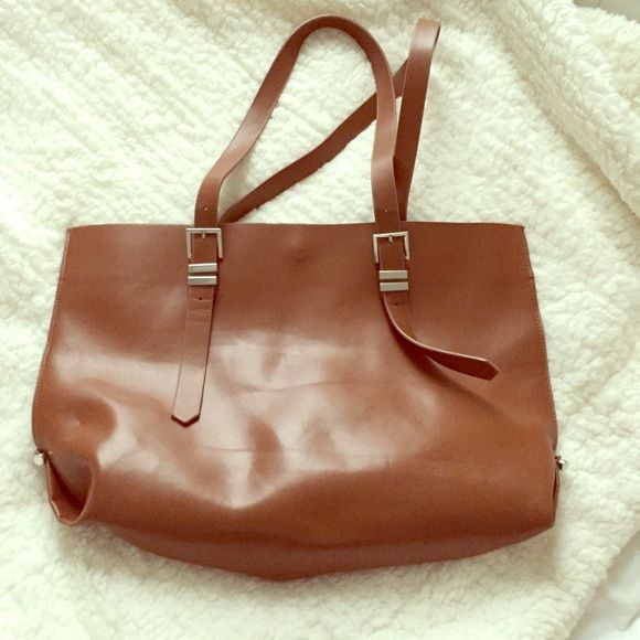 Zara Trafaluc tote Worn a handful of times. The strap stitching is a bit loose, but no other signs of wear that i can spot. 18 in. W by 12 in. L. I no longer have the dustbag for this. Zara Bags Totes