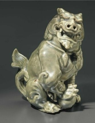 A Yaozhou celadon figure of a lion, Northern Song-Jin Dynasty, 12th-13th century