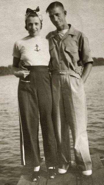 1940s found photo couple at the dock beach lake pants trousers sportswear knit top shirt bandana hair war era WWII vintage fashion style