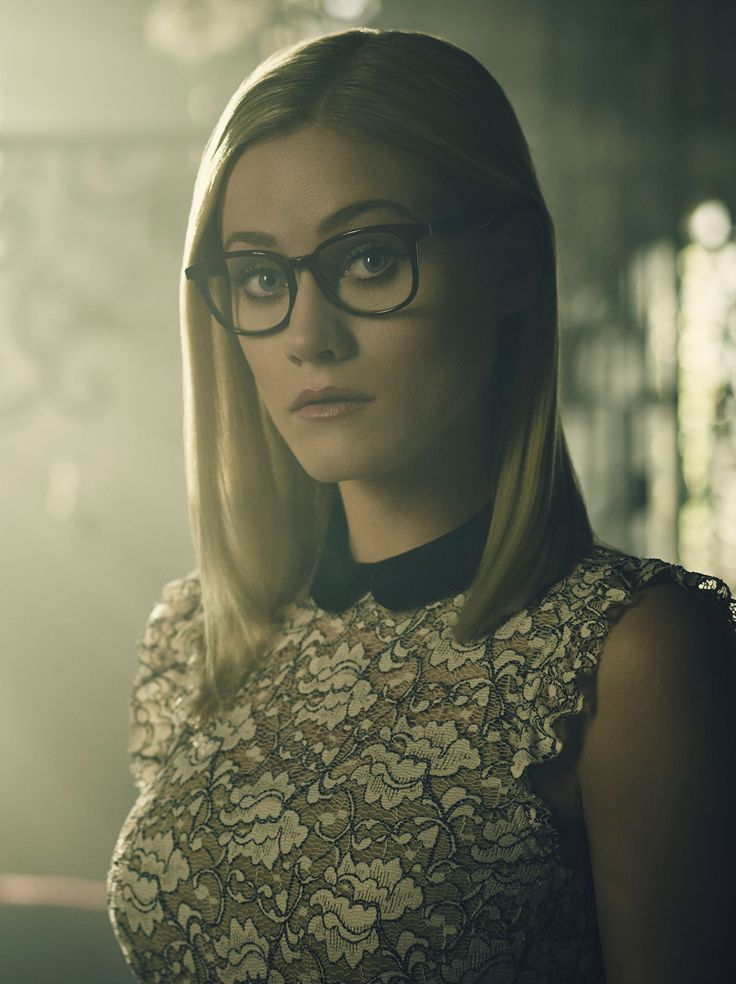Alice Quinn, The Magicians  Love, love, love these burgundy frames!  They look a lot like these Kate Spade eyeglasses: https://www.framesdirect.com/framesfp/Kate_Spade-paletgt/r.html?color=5017760    A phenomenally talented, but painfully shy magician with darkness in her past.