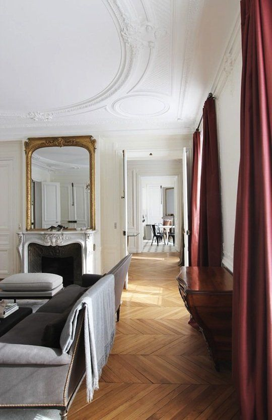 Paris apartment located in Odeon, designed by A+B Kasha - Paris, herringbone floors, ceiling -  Although Paris herringbone wooden floors are pretty, the downside is that walking across them can be very noisy, so a nice thick rug is a good way of muffling the noise and adding color