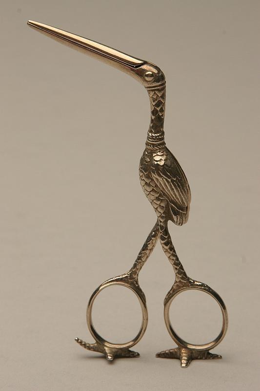 Tiffany sterling stork scissors is a ribbon threader.
