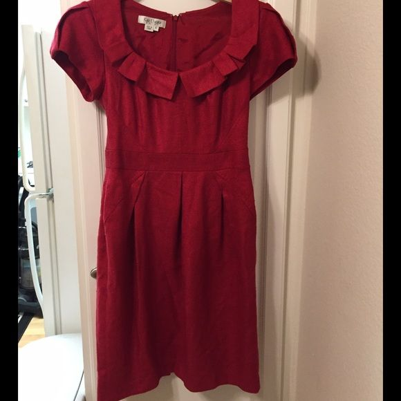 'Kay Unger' silk red dress with matching red belt Size 6. Pleated skirt hits below knee. Worn twice; excellent condition. Fall/winter oriented Kay Unger Dresses