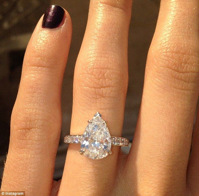 Pear shaped engagement ring. so pretty with or without halo. Not sure what weight the picture ring is, but 1.7-2 carats looks HUGE (and perfect) with the pear (or any elongated) shape.