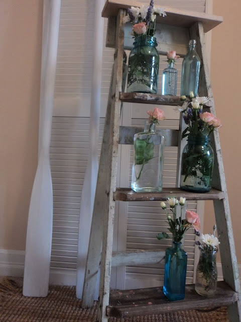 Use the steps of the ladder for shelving your favourite little bottles and some pretty flowers........D.