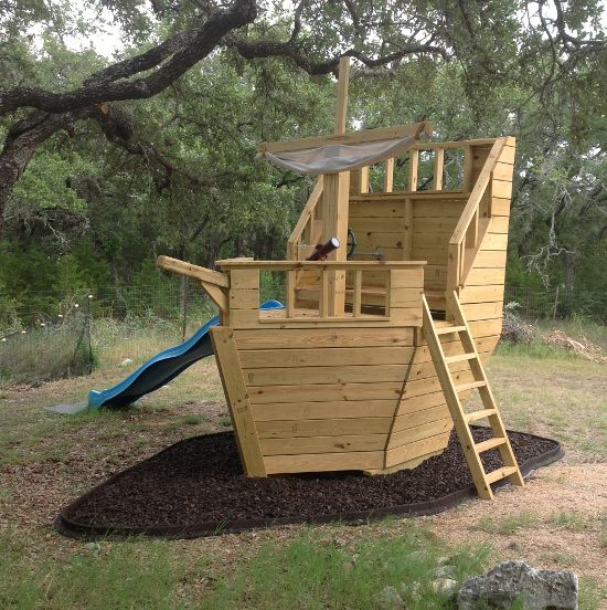 Build your own pirate ship playhouse how cool is this for How to make a playhouse out of wood