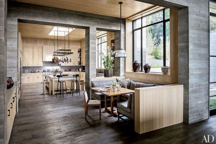 Scott Mitchell devised the breakfast area's table and its banquette, which is cushioned in a de Le Cuona linen, while Denise Kuriger designed the chair; the kitchen includes a pot rack custom made by Paul Ferrante, counter stools by Bourgeois Bohème, and a Wolf range