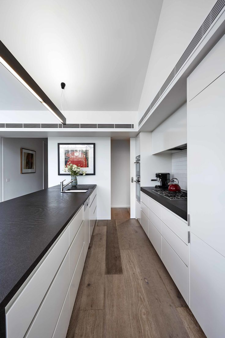 The streamlined kitchen features Miele cooktop, Sirius hood, Siemens oven, and Fisher & Paykel refrigerator.