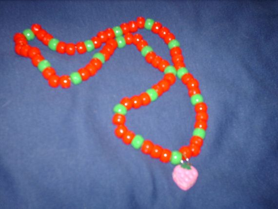 Brightly coloured red and green pony beads by CelestialStudio13, $14.00