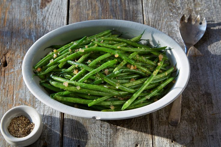 These are perfect green beans: simple flavors combined into an elegant dish that goes with almost anything Mr Pepin suggests a roast chicken, but they would pair equally well with a celebratory roast.
