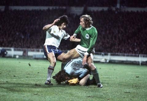 England 2 West Germany 0 in March 1975 at Wembley. Kevin Keegan and Berti Vogts clash as Sepp Maier grabs the ball #Friendly