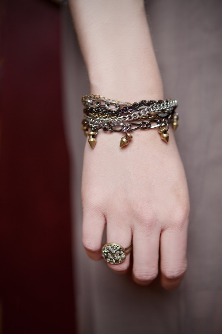 multi chain bracelet with metal spikes charms. $38.00, via Etsy.