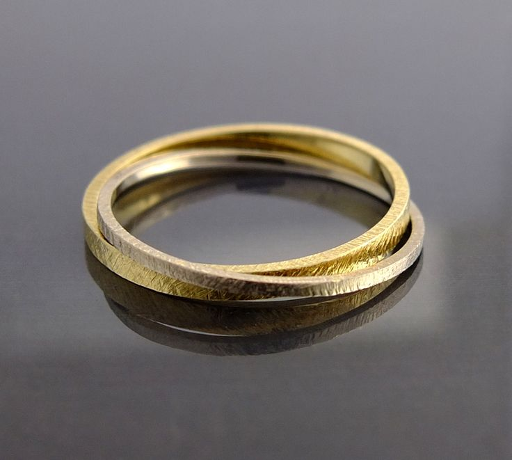 złota obrączka bizoe wykonana ręcznie z białego i żółtego złota pr. 0,585