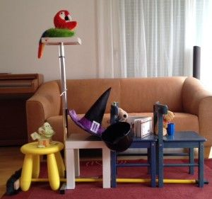 "Imaginative play with book, ""Room on the Broom""."