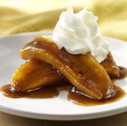 Easy banana dessert recipe made with bananas heated in a brown sugar glaze and topped with Reddi-wip