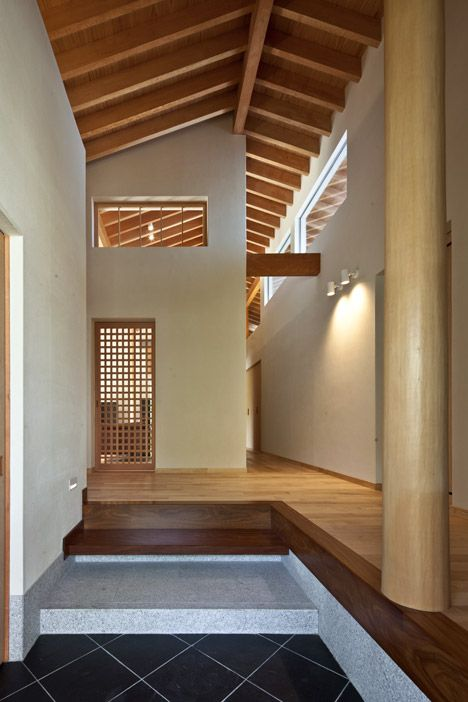 Timber-framed house designed to frame five separate gardens and terraces.