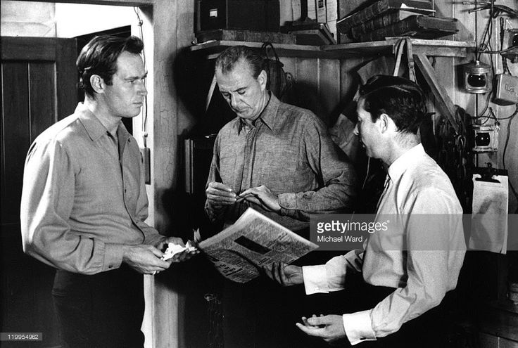 Actors Charlton Heston and Gary Cooper on the set of the film 'The Wreck of the Mary Deare' with director Michael Anderson, MGM Studios, Boreham Wood, Britain. 1959.
