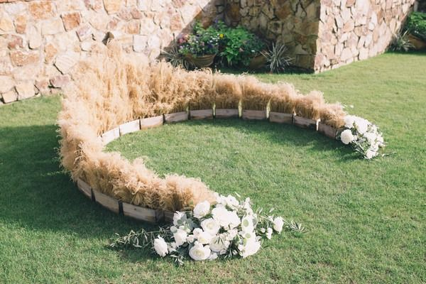 Rustic wedding ceremony decor - outdoor wedding ceremony - wooden boxes with hay and white flowers in a semi circle {Black & Hue Photography}