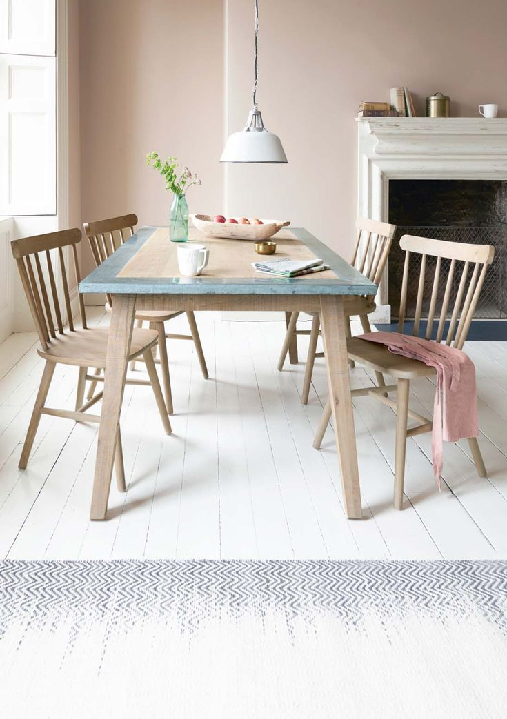 With its bandsawn oak top and vintage-y zinc trim, this cool kitchen table is absolutely brimming with character. And that galvanised edge will just keep getting better with age.