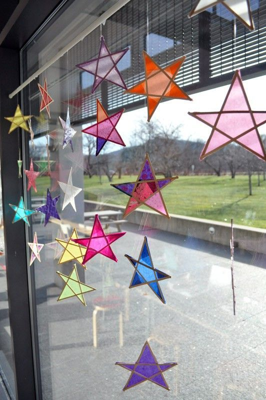 Wooden coffee stir sticks and tissue paper stars http://carlemuseum.org/blogs/making-art/wood-and-paper-stars