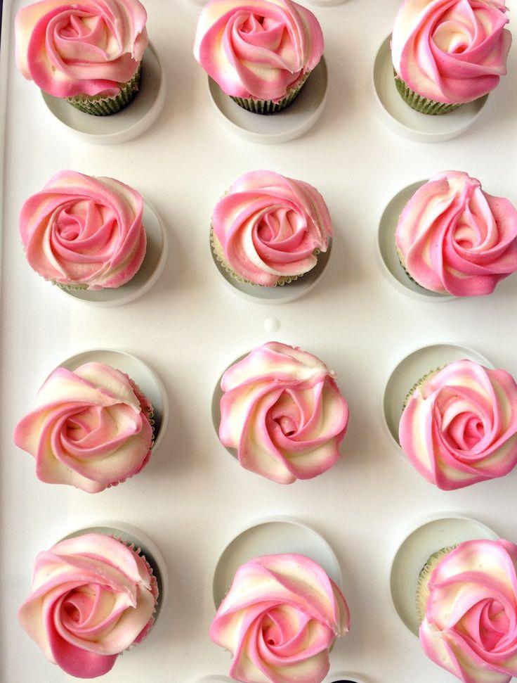piping buttercream rose swirl on eggless vanilla cupcakes