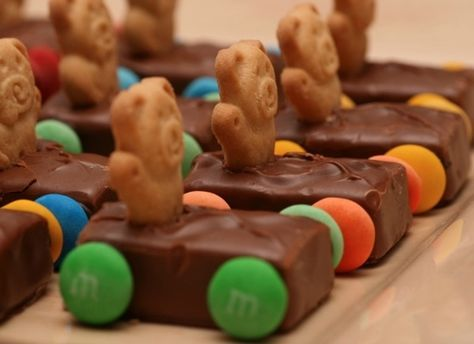 These are adorable! This candy snack is especially fitting for a boy's birthday party or any car themed party – made with Teddy Grahams, Milky Way bars, chocolate melts, and M's or Skittles.