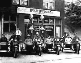 Old Harley Davidson motorcycles outside the shop... vintage.