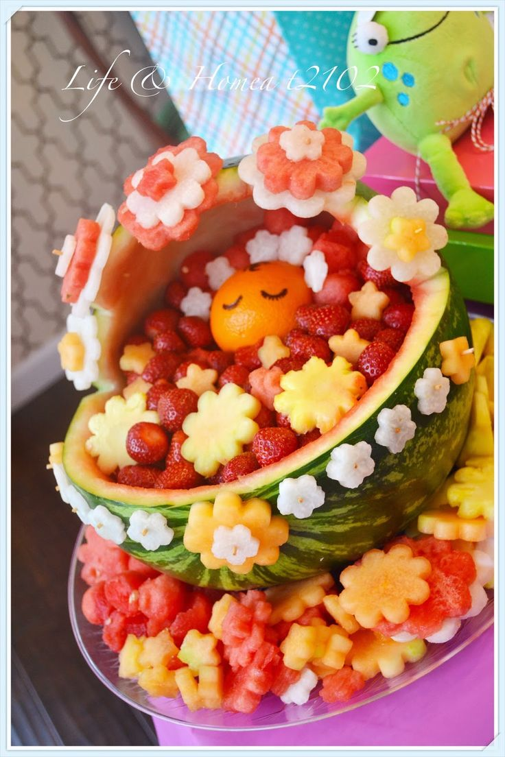 Life & home at 2102: A Baby Shower on a Budget - hollowed out watermelon and fruits cut with cookie cutters (no info on web site)
