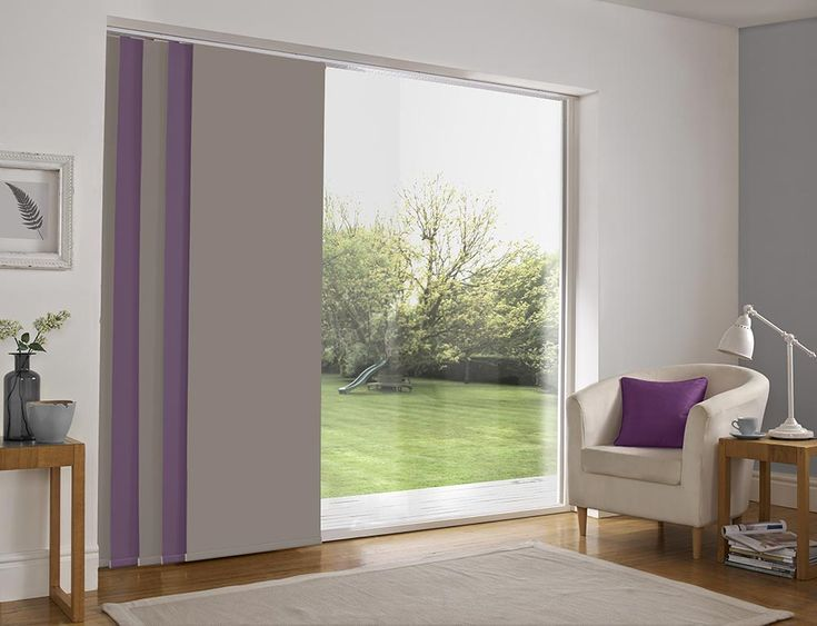 Panel blind is the most innovative shading solution for larger windows and patio doors. This blind also looks stunning as a stylish room divider. Here in purple and grey colour. Bolton Blind's panel blind is available in a diverse range of designs and fabrics including, sheer voiles and faux suede, all of which will enhance the decor of any room.