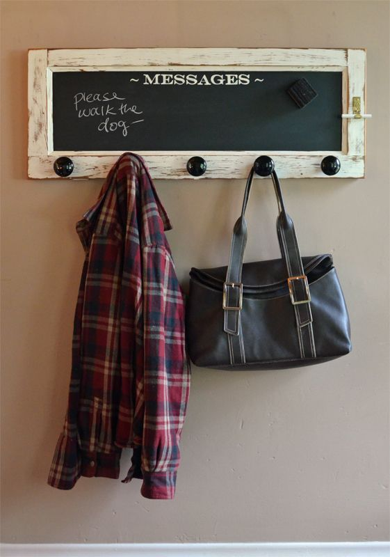 Use this unique wall mounted coat rack to organize your coats and bags! This coat rack is made from a vintage door, magnetic chalkboard, and vintage knobs.