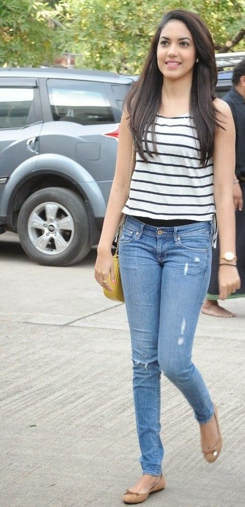 T-shirt And Denim, a Great Combo.... It is nice to know that even leading actors calm it down with their outfits once in a while. Ritu, on her busy day slips into a T-shirt & Denim dress and wears flats with the same, to look fun, effortless and yet fashionable... Own the look at https://www.estrolo.com/inspirationapp/t-shirt-denim/