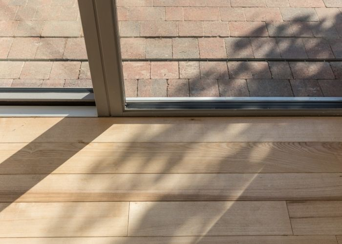 Low threshold sliding doors from Idealcombi's Futura+ range used in a passive house.