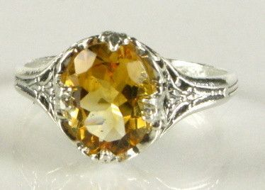 Lovely oval golden Citrine set in delicate vintage sterling setting. A great heritage piece. Size 6, can be sized by a good jeweler.