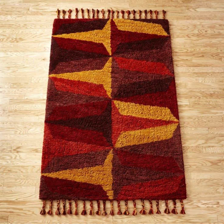 Shop Farrah Red Shag Rug.   Handloomed from New Zealand wool, this plush pile rug is over the top in the best way possible.