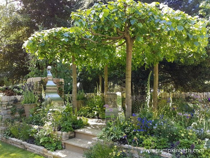he Poetry Lover's Garden, designed by Fiona Cadwallader, is one of the Artisan Gardens at the RHS Chelsea Flower Show 2017