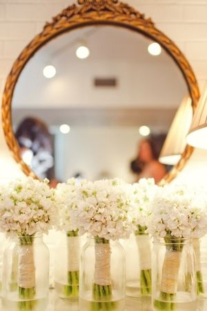 White Hydrangea Bouquets. Could put the bridesmaids bouquets on mason jars or vases on the tables