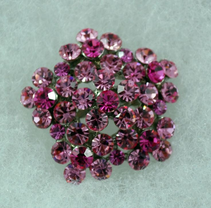 A personal favorite from my Etsy shop https://www.etsy.com/ca/listing/117977985/pink-flower-crystal-brooch
