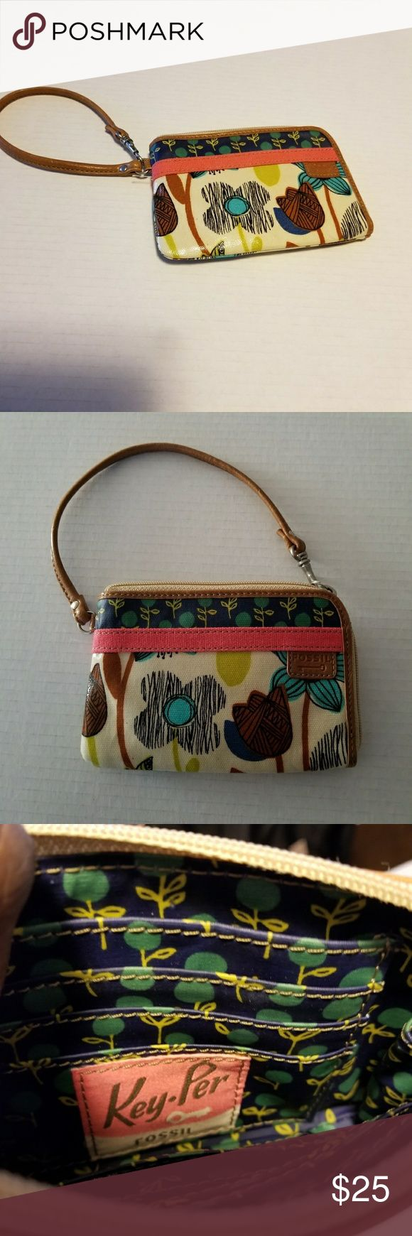 Fossil wristlet Key-Per floral pattern . Fossil wristlet Key-Per floral pattern   The inside has eight compartments for credit cards, business cards, ect. There still room for cell phone, cash. Strap can be used two ways notice in pictures. Fossil Bags Clutches & Wristlets