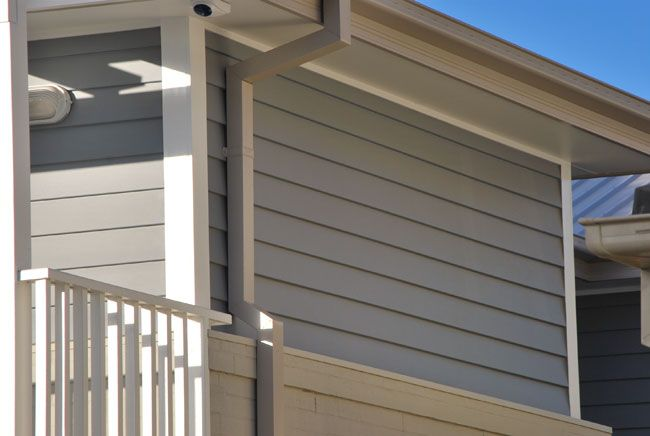 Dulux Milton Moon - Weatherboard and Rendered areas. Lexicon - Trims and front door.