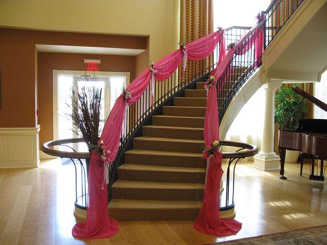 This Staircase With Its Elegant Pink Fabric Swags Provided