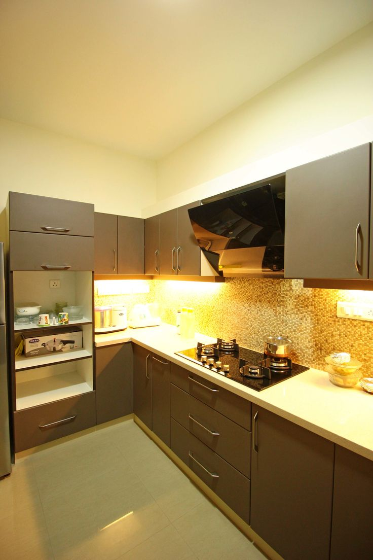 View of kitchen with white platform top and low height shaker cabinets and  over head units