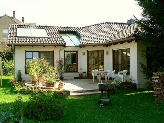 Modele fatade case - Galerie cu imagini pentru a capta atentia tuturor vecinilor / Casa parter dispusa in L cu ferestre mari sursa: http://www.renovat.ro