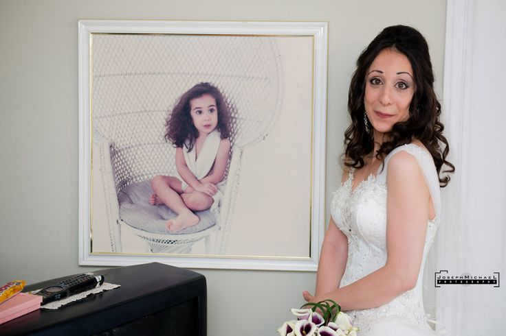Bride with baby picture imitating the picture, same big curly hair.