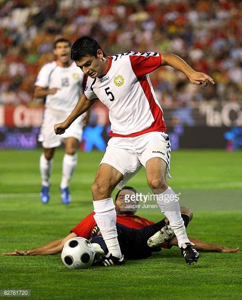 Hamlet Mkhitaryan of Armenia duels for the ball with Daniel Guiza of Spain during the FIFA2010 World Cup Qualifier match between Spain and Armenia at...