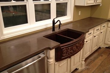 Concrete countertops and copper farmhouse sink that will make your jaw drop!