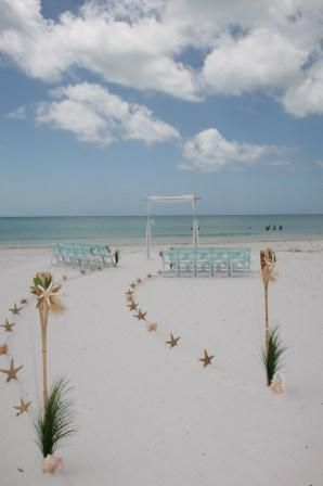 Siesta Key, Fl...sugar-fine, stark white sand and fantastic blue-green water!  Aqua chair sashes with starfish and raffia accents highlight the natural beauty of this beach and the bride to be!  Suncoast Weddings and Events!