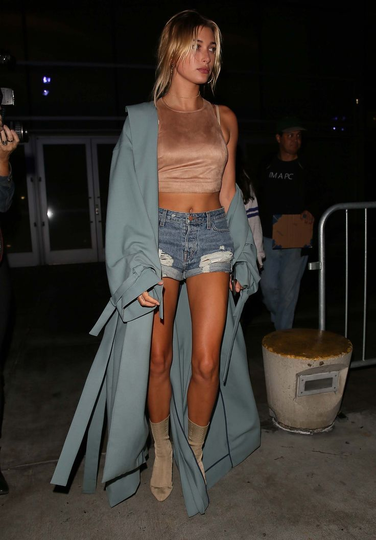 Hailey Baldwin in a pale blue sweeper, denim shorts, and nude crop top – celebri…